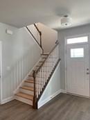 hardwood staircase at entranace